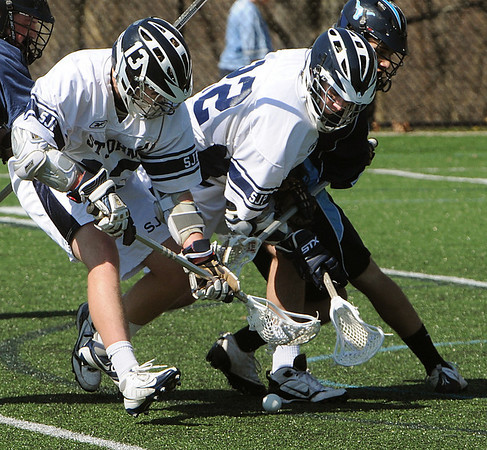 Danvers:<br /> From left, Bob Gallahue and Matt Steele of St. John's Prep, reach for the ball as Peabody's Cory Cronin  tries to go for it also, during the Peabody at St. John's Prep boys lacrosse game.<br /> Photo by Ken Yuszkus/Salem News, Saturday, April 3, 2010.