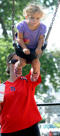 Beverly:<br /> Madison Marcell, 2, gets a push from her mother, Jamie, while on the swings at Dane Street Beach.<br /> Photo by Ken Yuszkus/The Salem News, Monday, August 20, 2012.