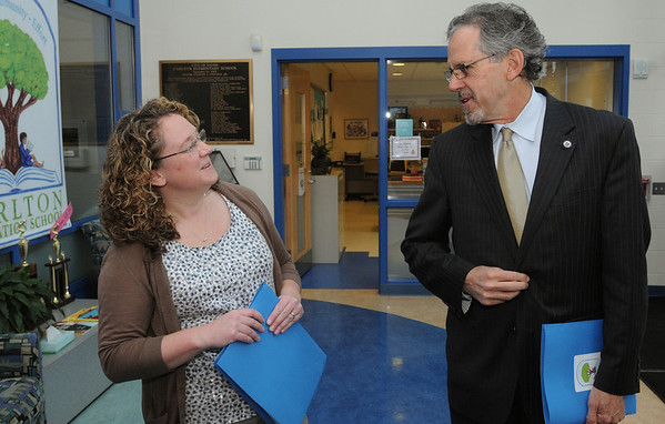 Salem:<br /> Jean-Marie Kahn, Carlton School principal, greets Paul Reville, Massachusetts Secretary of Education, as he arrives at the school for a visit.<br /> Photo by Ken Yuszkus/Salem News, Friday,  March 16, 2012