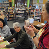 Peabody:<br /> Evelyn Rauseo, right, leads a hands-on decoupage and stamping workshop at the Peabody Institute Library. Roberta Hung, left, of Salem, and Deb Crowell, center, of Peabody, listen to Evelyn at the start of the workshop.<br /> Photo by Ken Yuszkus/Salem News, Wednesday,  February 22, 2012.