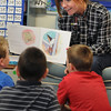 Danvers:<br /> Emily Janakas reads to some of her 2nd graders at Riverside School. She is a Merrimack College graduate student who is teaching at Riverside School this year as part of a new education fellowship program at Merrimack.<br /> Photo by Ken Yuszkus/Salem News, Friday, May 13, 2011.