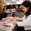 Middleton:<br /> Maria Polignone, cosmetology student, left, gives a manicure to Allison Johnston of Swampscott, who is visiting NorthShore Tech's Open House on Thursday evening.<br /> Photo by Ken Yuszkus/Salem News, Thursday, November 10, 2011.