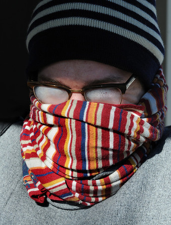 Salem:<br /> Yoann Rocaud has condensation on his glasses caused by exhaling with his scarf covering his nose. He was bundled up to fight the frigid temperatures while walking on Washington Street on Monday morning. Yoann is from France and is studying in Boston. <br /> Photo by Ken Yuszkus/Salem News, Monday, January 24, 2011.