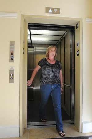 Salem:<br /> Deb DiGiulio, religious education director, exits the new elevator in the new addition at the  First Church in Salem, Unitarian.<br /> Photo by Ken Yuszkus/Salem News, Thursday, May 17, 2012.
