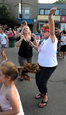 Danvers:<br /> Amy Rotberg, left, and Linda King dance on Maple Street to the music provided by the disc jockey during the Oldies Night at the Danvers Family Festival.<br /> Photo by Ken Yuszkus/Salem News, Wednesday, June 29, 2011.