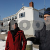 Beverly:<br /> Miranda Gooding, left, the chairwoman of the city's Harbor Management Authority, and authority member Donald Neuman, talk about the plan for  improvements of the waterfront while standing in front of the harbormaster's building.<br /> Photo by Ken Yuszkus/Salem News, Friday,  February 6, 2009.