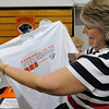 "Beverly:<br /> Marty Brandt, of Beverly, class of 1978, admires the printed t-shirt she just purchased which reads ""Farewell to the Fieldhouse BHS 04.23.2010"". Many people attended the farewell party for the high school field house, which is going to be demolished.<br /> Photo by Ken Yuszkus/Salem News, Friday, April 23, 2010."