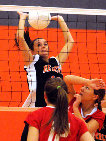 Beverly:<br /> Beverly's Andrea French, top, gets the ball back over the net during the Saugus at Beverly girls volleyball game.<br /> Photo by Ken Yuszkus/Salem News, Monday, October 17, 2011.