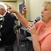 Beverly:<br /> Maureen Pilot sings while accompanied by pianist Dan Murphy and Pierre LeMieux on bass, as they perform a nostalgic review of wartime tunes from the World War II era, and how they reflected the times. The performance was at the Beverly Public Library on Monday morning.<br /> Photo by Ken Yuszkus/Salem News,  Monday,  November 8, 2010.