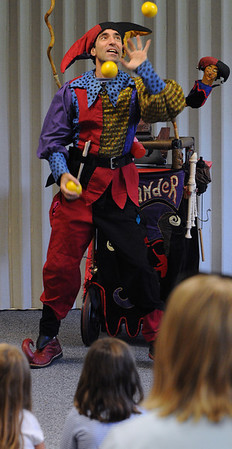 Swampscott:<br /> Alex the Jester juggles as he performs stunts, sight gags, physical feats, etc. at the Swampscott Public Library as the grand finale to the library's summer reading program.<br /> Photo by Ken Yuszkus/Salem News, Thursday, August 11, 2011.