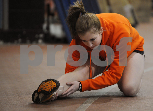 Beverly:<br /> Nicki Lemelin stretches before working out at the Beverly High School indoor track.<br /> Photo by Ken Yuszkus/Salem News, Wednesday,  January 14, 2009.