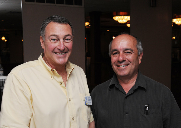Danvers:<br /> Neal Waldman, retired, left, and Tom Manuel, of TFM Realty, attend the Danvers Rotary meeting held at the Danversport Yacht Club.<br /> Photo by Ken Yuszkus/Salem News, Monday, May 3, 2010.