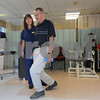 Swampscott:<br /> Kristen Arvidson, senior physical therapist, works with Bill Culbert, who is doing lunges in the gym at the Aviv Centers for Living Jewish Rehabilitation Center.<br /> Photo by Ken Yuszkus/Salem News, Thursday, July 16, 2009.