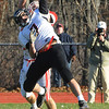 Topsfield:<br /> North Andover's Dan Laorenza, in front, breaks up an intended pass to Masco's Jake Gillispie at the North Andover at Masconomet football game on Thanksgiving Day.<br /> Photo by Ken Yuszkus/Salem News, Thursday, November 24, 2011.