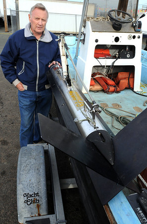 Lynn:<br /> Rick Horgan stands with his side scan sonar instrument and the boat which was used to find the missing Peabody woman's car in Flax Pond.<br /> Photo by Ken Yuszkus/Salem News, Thursday November 12, 2009.