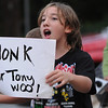 Ipswich:<br /> Sean Mellow yells to the passing motor vehicles to honk for Tony Woo along with others during the vigil held for Tony Woo at the center of town. Woo, owner of the Majestic Dragon restaurant on Route 1, was found dead on Tuesday, Sept. 27.  He was well-known and well-liked by folks in Ipswich.<br /> Photo by Ken Yuszkus/Salem News, Monday, October 3, 2011.