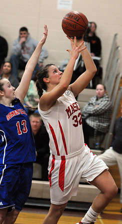 Topsfield:<br /> Masco's Brooke Stewart goes for her net during the Somerville at Masconomet girls basketball playoff home game.<br /> Photo by Ken Yuszkus/Salem News, Thursday,  March 1, 2012.