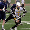 Peabody:<br /> Bishop Fenwick's Nick Coccoluto tries to get a handle on the ball during the Arlington Catholic at Bishop Fenwick boys lacrosse game.<br /> Photo by Ken Yuszkus/Salem News, Wednesday, April 13, 2011.