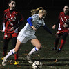 Danvers:<br /> Danvers' Corey Persson turns the ball in a corner near the net before taking a shot during the Tewksbury at Danvers girls soccer in Div. 2 North quarterfinal game.<br /> Photo by Ken Yuszkus/Salem News,  Tuesday,  November 9, 2010.