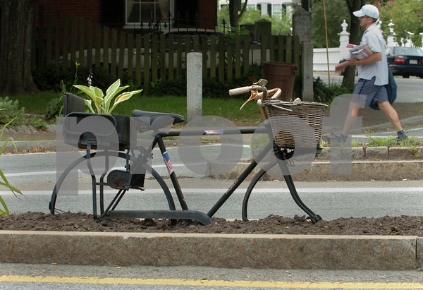 Salem:<br /> A plant grows on bicycle planted into the ground on a traffic island on Summer/North Street near Essex Street.<br /> Photo by Ken Yuszkus/Salem News, Thursday, July 16, 2009.