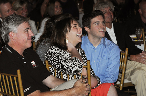 Danvers:<br /> Sen. Fred Berry's family members from left, Allen, Alexandra, and William Pitzer laugh at one of the many comical remarks by Sen. Fred Berry. Sen. Fred Berry was feted at the Danversport Yatch Club in advance of his retirement, with a sold-out event that will benefit the Fred Berry Charitable Fund.<br /> Photo by Ken Yuszkus/The Salem News, Thursday, September 13, 2012.