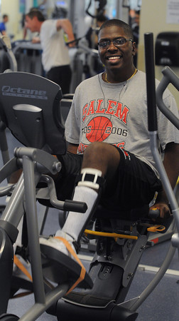 Salem:<br /> Gregory Martinez is working out at Lynch, Van Oterloo YMCA. Gregory was paraylzed after being hit by car few years ago. He is going to graduate from Salem High on June 1 and walk across stage with the aid of a walker.<br /> Photo by Ken Yuszkus/Salem News, Monday, May 21, 2012.