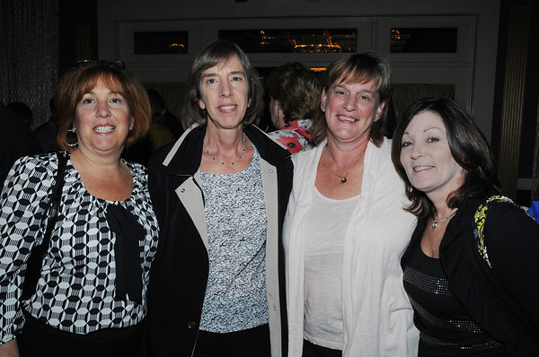 Danvers:<br /> From left, Annamaria Piatelli, Andrea Downing, Betty Pickering, and Cindy Cianfrocca, all of Danvers, attend the Danvers Educational Enrichment Partnership's 13th Wine and Food Tasting at the Danversport Yacht Club.<br /> Photo by Ken Yuszkus/Salem News, Thursday, October 13, 2011.