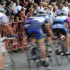 Beverly:<br /> The racers in the Masters category pedal by the bystanders on Cabot Street during the Third annual Beverly Gran Prix cycling race.<br /> Photo by Ken Yuszkus/Salem News, Wednesday, August 3, 2011.