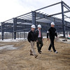 Danvers:<br /> From left, Jay Connolly, project manager, and Steve Connolly, owner, both of Connolly Brothers Inc., and Kelly Cragg, who will operate the new soccer complex, walk near the steel structure that the Connolly Brothers Inc. built as an indoor soccer complex in Danvers.<br /> Photo by Ken Yuszkus/Salem News, Monday, February 14, 2011.