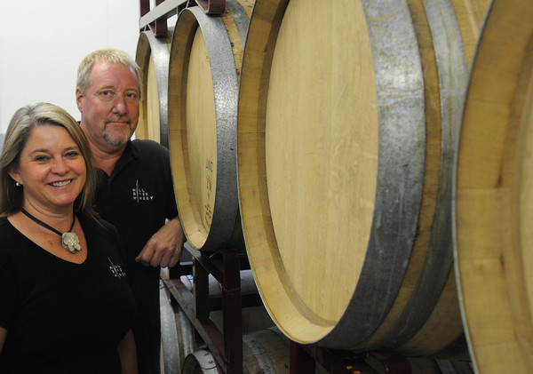 Rowley:<br /> Donna Martin and Rick Rouseau of the Mill River Winery stand near French oak barrels used in aging some of their wines.<br /> Photo by Ken Yuszkus/Salem News, Friday, July 20,  2012.