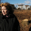 Beverly:<br /> Nancy Cunningham, who lives in the Dunham Road Castle condominiums in the background, looks out at Route 128. She is upset after Cummings Properties cut down hundreds of trees in front of her building.<br /> Photo by Ken Yuszkus/Salem News, Monday, January 30, 2012.