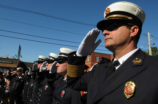 Danvers:<br /> Danvers Fire Chief Kevin Farrell, right, salutes the fallen firefighters from 9/11, along with his firefighters, during the 9/11 ceremony in front of the Danvers Fire Department Sunday morning. <br /> Photo by Ken Yuszkus/Salem News, Sunday, September 11, 2011.
