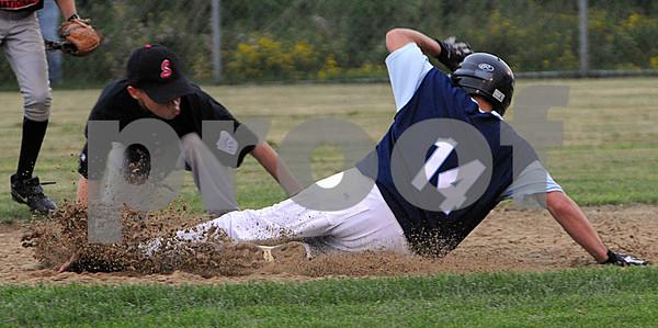 Peabody:<br /> Salem National's Ed Ortiz tags out Peabody National's Jordan Manthorne at second base.<br /> Photo by Ken Yuszkus/Salem News, Friday, June 26, 2009.