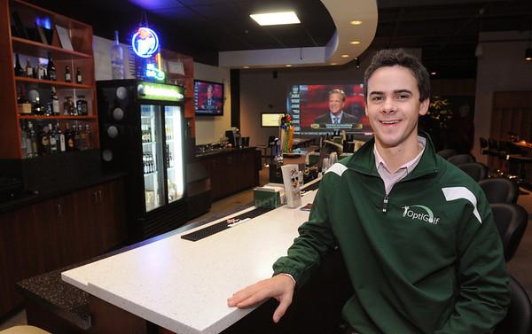 Middleton:<br /> Caleb Reinhold, general manager at Optigolf, sits at the bar of the indoor golf facility.<br /> Photo by Ken Yuszkus/Salem News, Thursday, December 15, 2011.