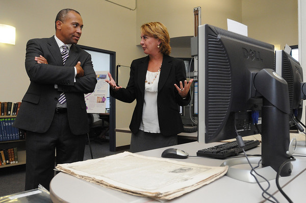 Ipswich:<br /> Governor Deval Patrick listens to Stephanie Pearsall of EBSCO Publishing, explain the scanning process at EBSCO Publishing. The governor was at EBSCO Publishing to celebrate the company's expansion and the creation of 90 new jobs.<br /> Photo by Ken Yuszkus/Salem News, Wednesday, September 14, 2011.