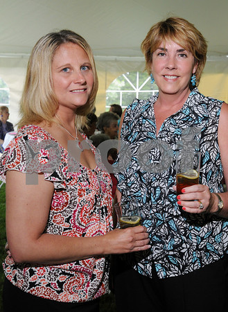 Danvers:<br /> Kyle Donovan, left, and Anne Danehy, both of Danvers, have a glass of iced tea together at the Danvers Historical Society fashion show and fundraiser held at Glen Magna Farms. <br /> Photo by Ken Yuszkus/Salem News,  Wednesday, June 3, 2009.