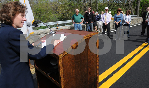 Hamilton:<br /> Luisa Paiewonsky, commissioner of Massachusetts Highway, addresses the assembled group of people at the reopening of the Highland Street/Mill Road bridge. The bridge was closed for three years.<br /> Photo by Ken Yuszkus/Salem News, Friday May 8, 2009.