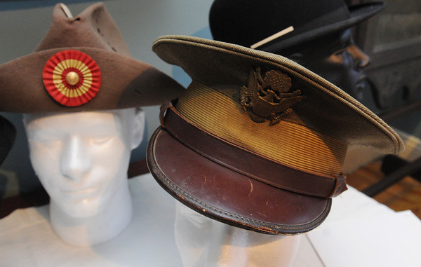 Peabody:<br /> Left, is a GAR slouch hat and the right, is a officer's hat from 1917-1918, which are part of the Hats Off to History and Art exhibit.<br /> Photo by Ken Yuszkus/Salem News, Thursday, July 7, 2011.