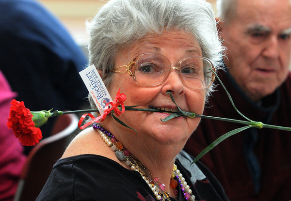 Beverly:<br /> Maggie Dehler with her carnation which she received at the Valentine's Day party at the Beverly Senior Center on Tuesday.<br /> Photo by Ken Yuszkus/Salem News, Tuesday, February 14, 2012.