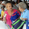 Beverly:<br /> Carol Cecchini, left, and Hazel Bickford, both of Beverly, chat in line while collecting free gifts from the various vendors under the tent during the Senior Citizens Day at Lynch Park in Beverly<br /> Photo by Ken Yuszkus/Salem News, Thursday August 5, 2010.