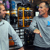 Beverly:<br /> Boston Marathon legend Dick Beardsley, right, speaks with Wes Lassen, an employee at New England Running Company, about past Boston Marathons. Dick Beardsley was at New England Running Company, signing his book (and posters) Wednesday afternoon.  <br /> Photo by Ken Yuszkus/Salem News, Wednesday, April 11, 2012.