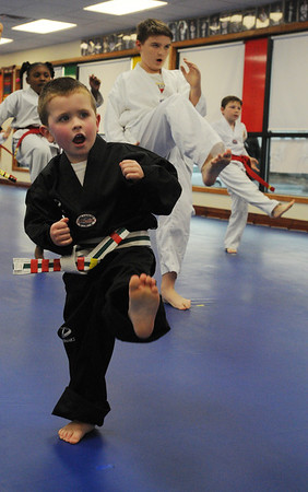 Beverly:<br /> Wilaen Fox during practice of the childrens all belt class at DW Kim US Tae Kwon Do studio on Friday.<br /> Photo by Ken Yuszkus/Salem News, Friday, December 2, 2011.