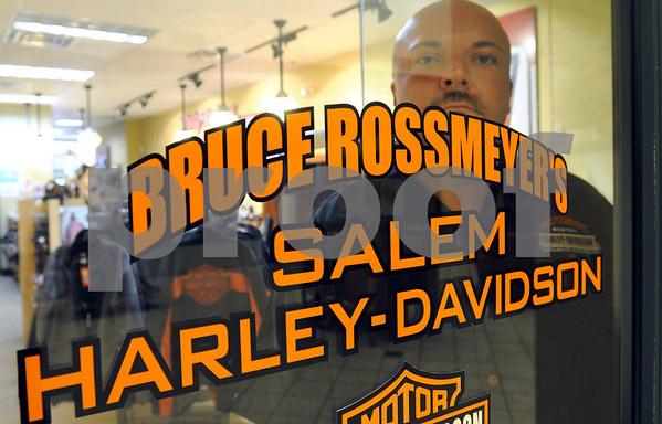 Salem:<br /> Michael Sienkiewicz, general manager of the Bruce Rossmeyer's Salem Harley-Davidson store that recently opened, stands behind the door with the store's name. The store sells a variety of merchandise displaying the Harley-Davidson name.<br /> Photo by Ken Yuszkus/Salem News, October 7, 2008.