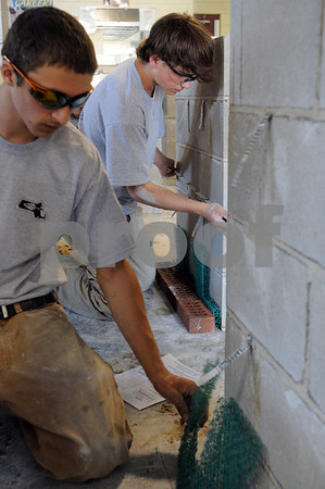 Middleton:<br /> Joe Flynn, left, of Middleton and Shane Bennett of Danvers are making a five course block wall during the masonry competition at the North Shore Technical High School.<br /> Photo by Ken Yuszkus/Salem News, Wednesday May 13, 2009.