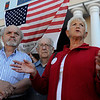 Danvers:<br /> Joan Greener, aunt of Karen Martin who was the head flight attendant on flight 11 who perished on 9/11, speaks during the observance of the 9/11 attacks while in front of New Brother's Deli in Danvers. On the right is her husband Bill Greener. From left is Kyriakos Andrinopoulos, co-owner of New Brother's Deli and Robert Kelly, who both spoke during the ceremony.<br /> Photo by Ken Yuszkus/Salem News, Saturday,  September 11, 2010.