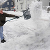 Salem:<br /> Vince Swiniuch throws a shovel full of snow as he shovels his driveway during the snowstorm on Monday morning.<br /> Photo by Ken Yuszkus/Salem,  News, Monday,  December 27, 2010.