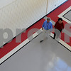 Salem:<br /> Vincent Dube, project architect, and Darleen Mellis, school building committee chairman, walk on the painted graphics on the floor of the lobby of the newly renovated Salem High School. The floor design was recently completed.<br /> Photo by Ken Yuszkus/Salem News, Monday September 15, 2008.