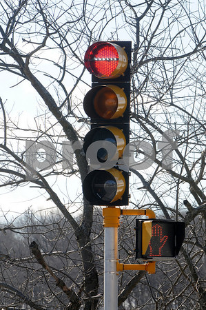 Beverly;<br /> The red light of the traffic light on Elliott Street across from McKay Street is very distinctive. The flashing bar across the red light is the only one in the state.<br /> Photo by Ken Yuszkus/Salem News, Monday,  February 9, 2009.