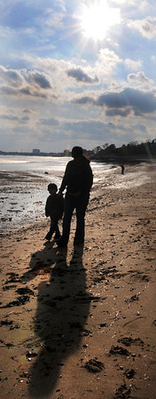 Beverly:<br /> Carri Pages and her nephew, Robert McMahon, 4, both of Beverly, walk along Dane Street Beach looking for sea glass on Monday afternoon.<br /> Photo by Ken Yuszkus/Salem News, Monday, October 24, 2011.