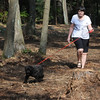 Beverly:<br /> Linda Davis and her dog, Bradley, walk in the area that is being cleared for a future dog park near the Beverly Airport.<br /> Photo by Ken Yuszkus/Salem News, Monday, July 11, 2011.